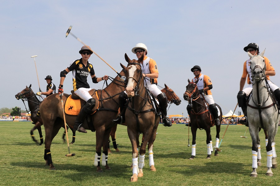 Polo players take part in the Ninth Annual Veuve Clicquot Polo Classic at Liberty  (Photo by Neilson Barnard/Getty Images for Veuve Clicquot)
