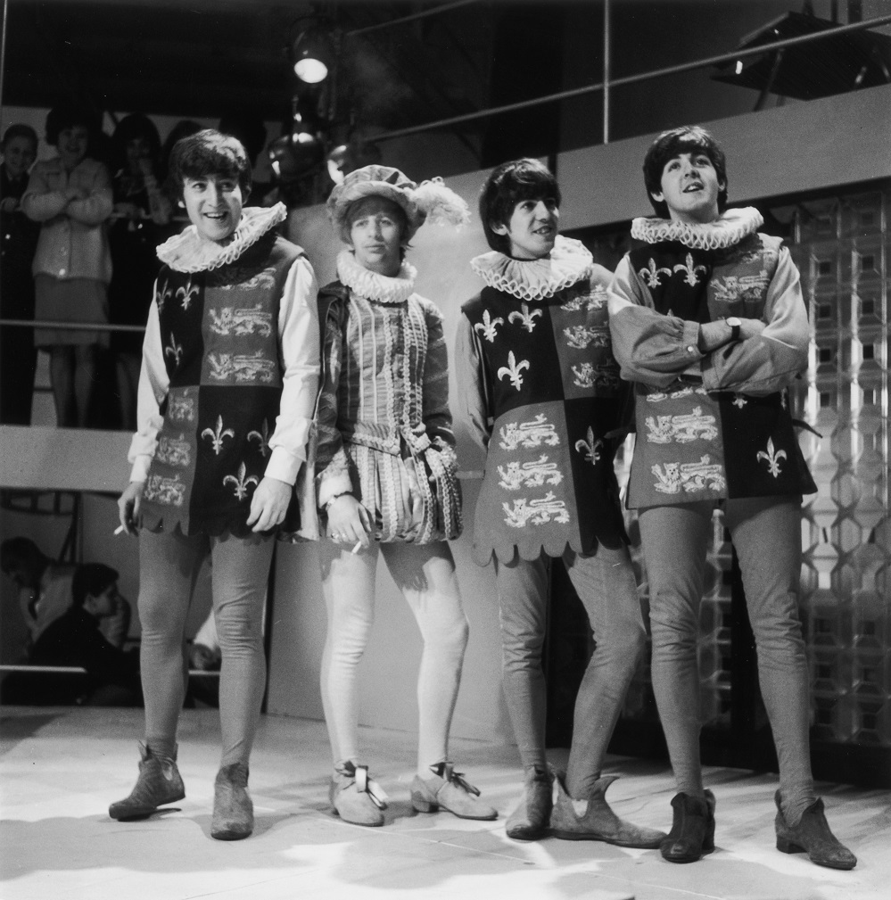 28th April 1964: The Beatles in tudor costumes during rehearsals for Redifussion's television programme 'Round The Beatles'. Left to right : John Lennon (1940 - 1980), Ringo Starr, George Harrison (1943 - 2001) and Paul McCartney. (Photo by Roger Jackson/Central Press/Getty Images)